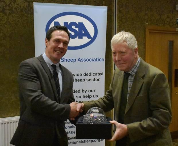 NSA Northern Region Chairman Thomas Carrick presents James Porter with his award