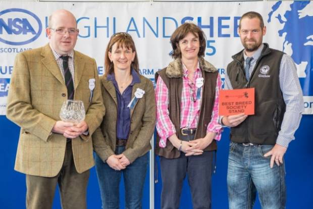 The rosebowl for the best breed society stand was presented to Kevin  Hunter (left), chairman of the Inverness and North branch of the  Blackface Sheep Breeders Association, and branch secretary, Ben Reive,  by the judges, Mrs Fiona Scott (second left) an
