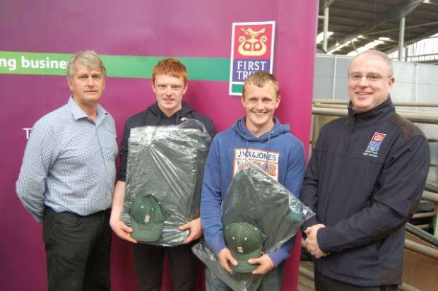 Young Shepherd of the Year Russell Smyth (inside right) and best under 18-year-old Iain Wilson (inside left) receive their prizes from Event Organiser Edward Adamson (left) and First Trust Bank's Kieran Mailley (right).