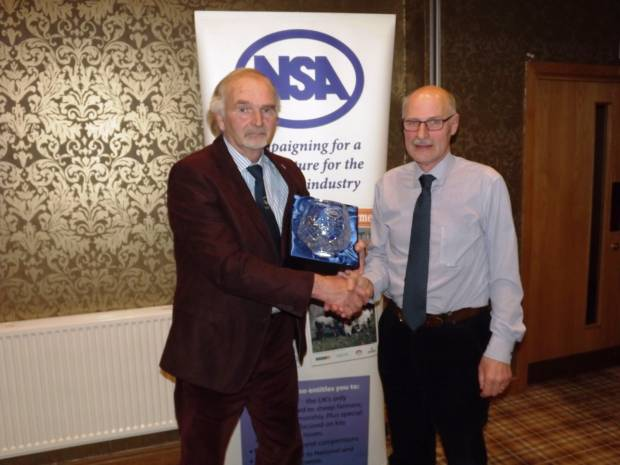NSA Northern Region Chairman Eddie Eastham (right) presents the award to Alan Alderson.