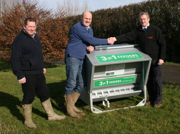 Antony Spencer (centre) accepts his prize from Robert Ball of Advantage Feeders (right) and Kevin Harrison, NSA Marches Region Chairman (left)
