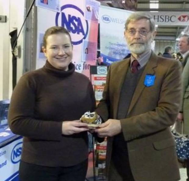 Catherine Nakielny receives her award from NSA Cymru/Wales Chairman David Pettendreigh