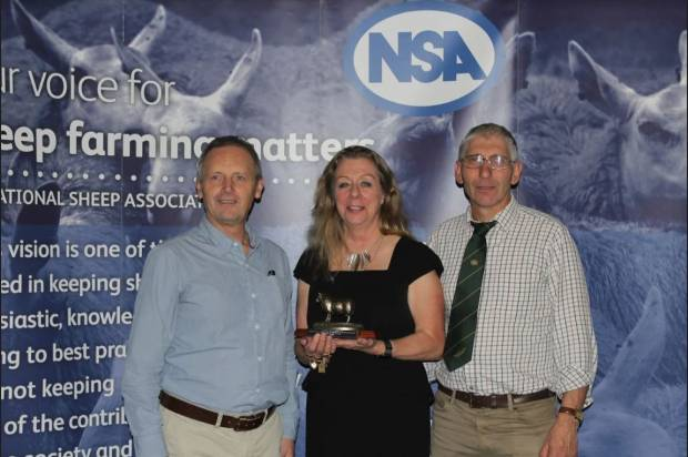 Sheep consultant, Lesley Stubbings with her award, presented by NSA Chief Executive, Phil Stocker and NSA Chairman Bryan Griffiths.