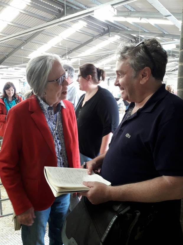 William Booth chats with Mrs Burrough, those husband sells regularly at the sale