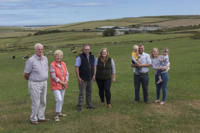 Highland sheep hosts, Kenneth and Elspeth Sutherland (left), with sons, Stephen (centre) and his fiancee, Alix Brown, and Jack and his wife, Fiona, with their two children, Jack and Amy, and Sibmister house and steading in the background