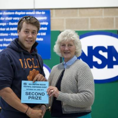 Young Shepherd of the Year Winner, George Hartley-Webb , collects his prize from Lady Paice at NSA Youthful Shepherd Event 2013.