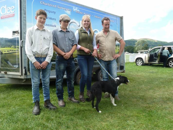 Top price sheepdog pictured with buyers