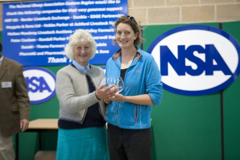 Young Shepherd of the Year 2013 Winner, Marie Prebble, collects her prize from Lady Paice at NSA Youthful Shepherds Event 2013.
