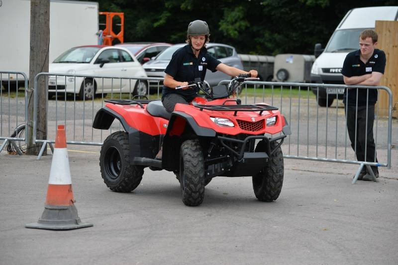 A competitor in the quad bike rounds of the Young Shepherd of the Year Competition at NSA Sheep Event 2014.