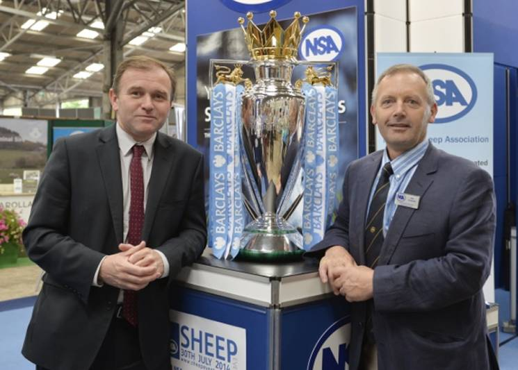 Farming Minister George Eustice (left) and NSA Chief Executive Phil Stocker with the Barclays Premier League trophy