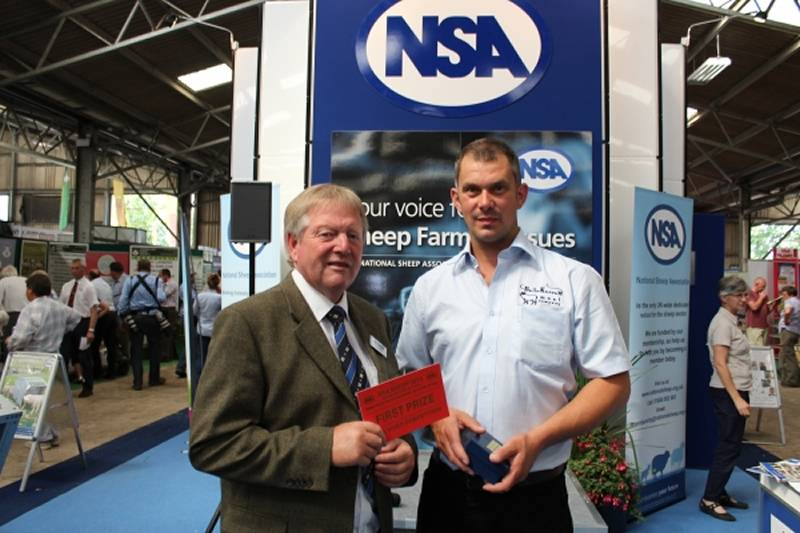 Agri-Lloyd's Charles Honey presents top prize in the NSA Sheep Event video competition to a representative of winner Krista Magee