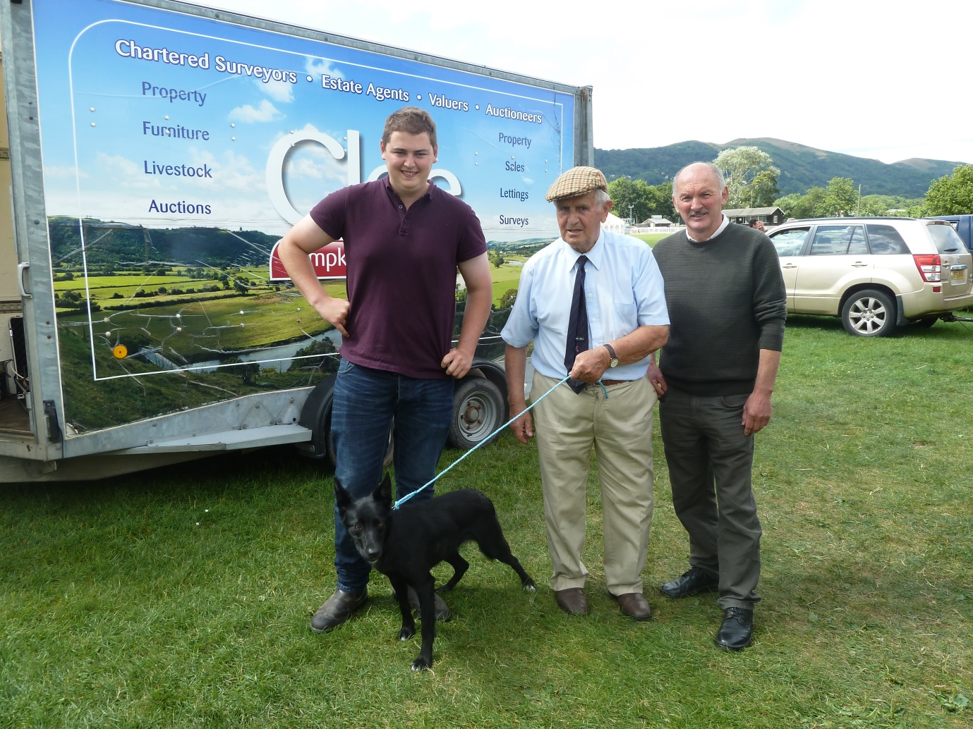 Sheepdog sale second top price pictured with vendor Trevor Morgans and buyer